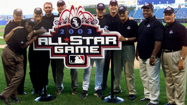 Aug. 7, 2002: Past and present Chicago White Sox All-Stars, from left, Bill Skowron, Minnie Minoso (leaning on sign), Bill Melton, Ed Farmer, Ron Kittle,Mark Buehrle, Carlton Fisk, Chico Carrasquel, Carlos May and BillyPierce pose for a photo in Chicago's Comiskey Park, with the logo for the 2003 All-Star Game, which is scheduled to be played at Comiskey Park. (Reuters)