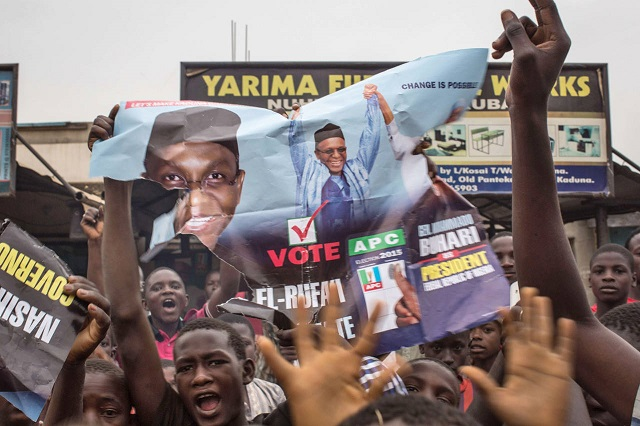 Hundreds of Nigerians celebrate the victory of opposition candidate Muhammadu Buhari in the northern city of Kaduna on Tuesday.